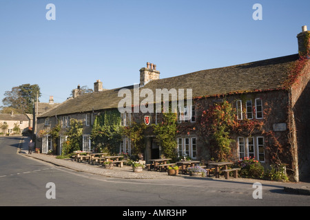 Red Lion and Manor House Hotel front with outdoor tables in Yorkshire Dales National Park village. Burnsall Wharfedale - Stock Photo