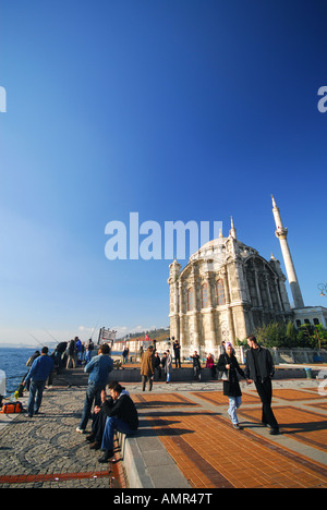 ISTANBUL. Sunday morning by the Mecidiye Mosque on Iskele Meydani in Ortakoy on the European shore of the Bosphorus. - Stock Photo