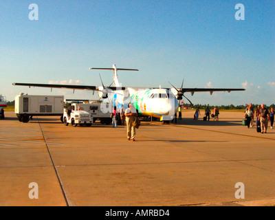 Passengers disembark Siem Reap Airways ATR 72 Siem Reap Airport Cambodia - Stock Photo
