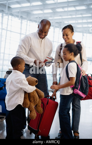 African family in airport - Stock Photo