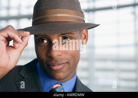 African man tipping hat - Stock Photo
