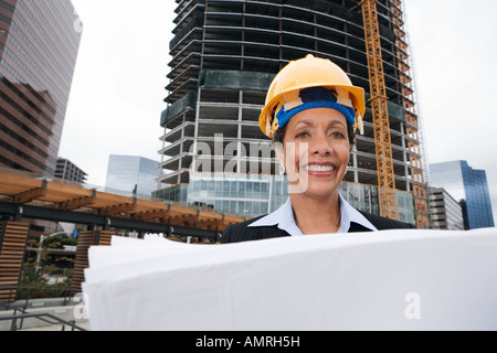 African businesswoman wearing hard hat - Stock Photo