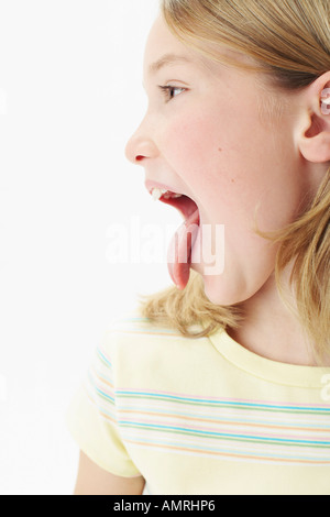 Girl Sticking Tongue Out - Stock Photo
