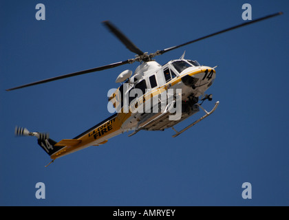 An LA County Fire helicopter in flight, California. - Stock Photo