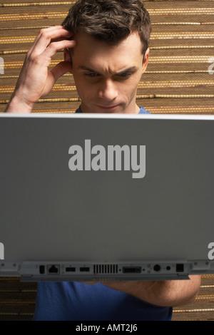 Man Using Laptop - Stock Photo