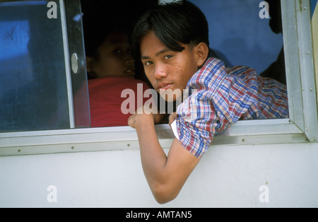 Philippines Boy Looking Out Bus Window - Stock Photo
