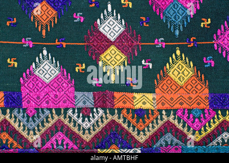 Detail of Bhutanese brocaded fabric with sumptuous supplementary weft brocading Woven on a hip strap loom Bhutan - Stock Photo