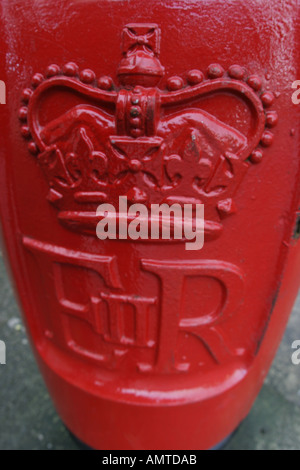 traditional Post box red ER UK mail delivery - Stock Photo