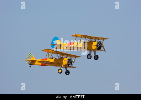 2 Boeing Stearman PT-17s flying together at airshow - Stock Photo