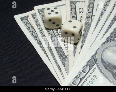 Gambling Dice and USA One Hundred Dollar Bills - Stock Photo
