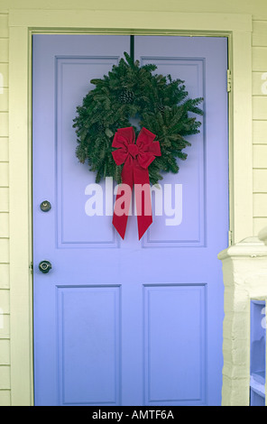 Christmas wreath on door of private home - Stock Photo