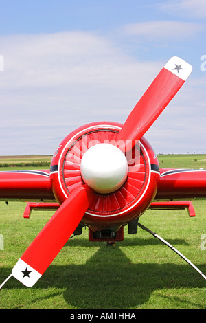 Front sight o a red Yak 55, legendary russian aerobatic aerplane, with propeller in diagonal - Stock Photo