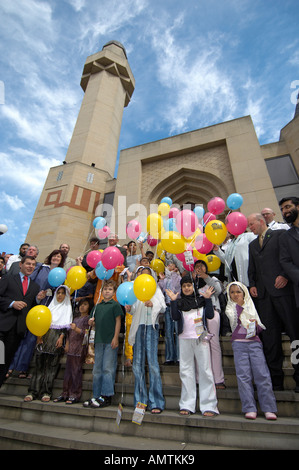 People and children with coloured balloons at Edinburgh Central Mosque - Stock Photo