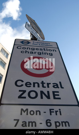 road sign indicating London's central zone congestion charge area, and days and hours of operation - Stock Photo