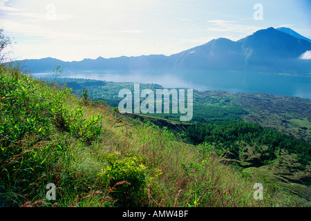 An early morning view of Lake Batur and the Batur caldera seen from near the summit of the Batur volcano Bali Indonesia - Stock Photo