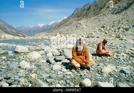 Sadhus holy men meditate at the source of the River Ganges at Gaumukh in the Himalayas near Gangotri Uttar Pradesh - Stock Photo
