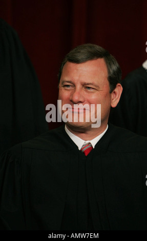Chief Justice John Roberts participates in the formal press photograph of the Justices of the United States Supreme - Stock Photo