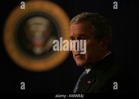 President George W Bush speaks before he signs HR 6111, the Tax Relief and Health Care Bill - Stock Photo