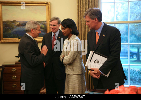 Condoleezza Rice confer while George W Bush and President Roh Moo-Hyun of South Korea answer questions from the - Stock Photo