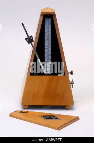Wittner beechwood clockwork metronome with cover removed. Made in Germany . - Stock Photo