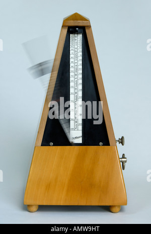 Wittner beechwood clockwork metronome with cover removed, working . Made in Germany . - Stock Photo