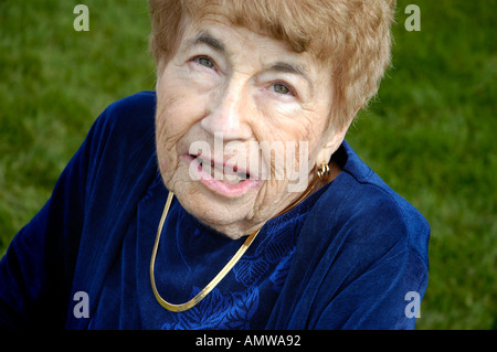 Woman at Family gathering with relatives 90 years old - Stock Photo