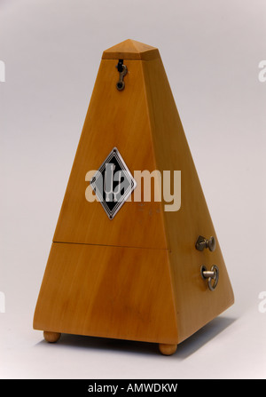Wittner beechwood clockwork metronome . Made in Germany . - Stock Photo