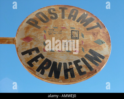 German sign of the post office at blue sky in the Mennonite colony, Filadelfia, Fernheim, Gran Chaco, Paraguay - Stock Photo