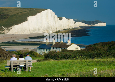 The Seven Sisters cliffs and the coastguard cottages seen from Seaford Head across the River Cuckmere Sussex England - Stock Photo