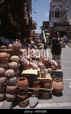 old cooking pot shop in Sana'a market Yemen - Stock Photo