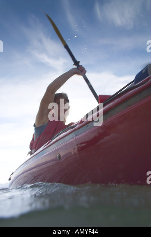 Water Level View of Kayaker Paddling SE AK Digital Summer - Stock Photo