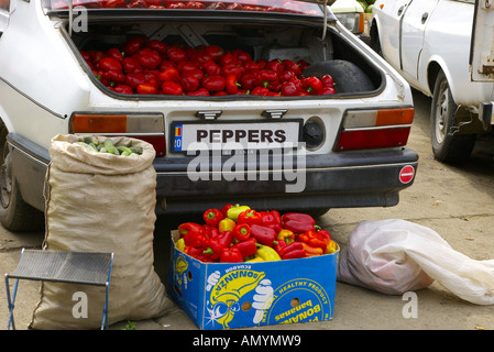 Full of Peppers in a car boot in a fruit market in a poor countryside town in Wallachia or Transylvania in Romania - Stock Photo