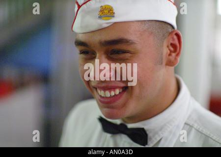Miami Beach Florida Ocean Drive South Beach Johnny Rocket's Restaurant male waiter uniform - Stock Photo