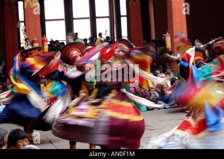 Bhutan Paro Festival Tsechu Dance of the Black Hats Shanag blurred dancers - Stock Photo