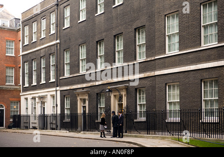 UK London Whitehall Downing Street people talking to policeman outside number 10 - Stock Photo