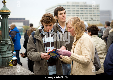 UK London South Bank lost tourists looking at map on Westminster bridge - Stock Photo
