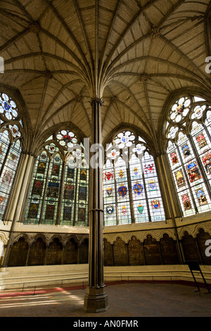 UK London Westminster Abbey Chapter House vaulted ceiling windows and encaustic tiled floor - Stock Photo