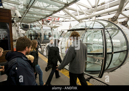 UK London South Bank BA London Eye passengers boarding capsule - Stock Photo
