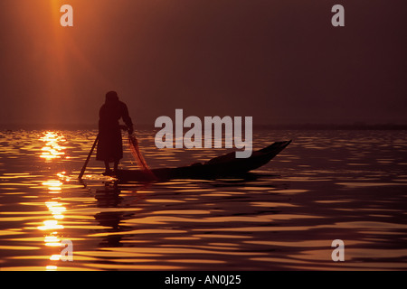 Leg rowing fisherman boat on Inle Lake at sunrise near Nyaung Swe Shan State Burma Myanmar (c) Maciej Tomczak / - Stock Photo