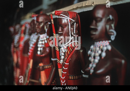 Selection of hand made sculptures of Masai warriors sold as souvenirs on a market stall As sold throughout Kenya - Stock Photo