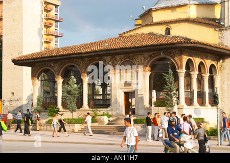 The Ethem Bey Beu Mosque. People on the street in front. The Tirana Main Central Square, Skanderbeg Skanderburg - Stock Photo