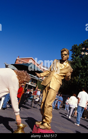 Mime Painted With Gold Perfroms On Corner Of Jackson Square In French Quarter During Mardi Gras New Orleans LA - Stock Photo