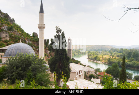 View over the town with mosque and church towers. River Neretva. Pocitelj historic Muslim and Christian village - Stock Photo