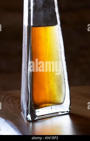 Rakija grappa type spirit flavoured with herbs backlit, Travarica, Toreta Vinarija. Detail Toreta Vinarija Winery - Stock Photo