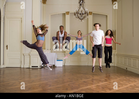 Group of people jumping in dance class - Stock Photo
