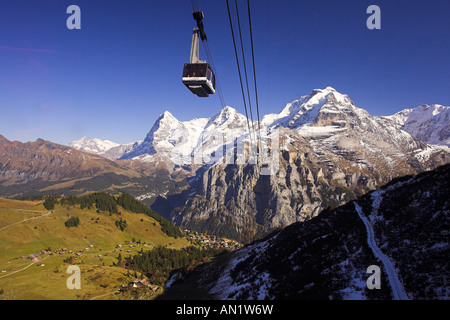Look from Schilthorn with ropeway train Bahn to Eiger l Moench M Jungfrau r Switzerland - Stock Photo
