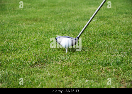 tee off and driving the golfball - Stock Photo