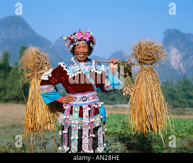 Farming Woman Dressed in Ethnic Costume, Guilin / Yangshou, Guangxi Province, China - Stock Photo