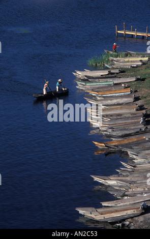 Fishermen in canoes heading for shore Santiago Atitlan Lake Atitlan Guatemala - Stock Photo