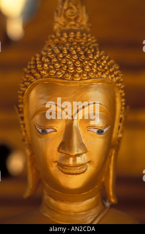 Gold painted Buddha That Luang Laos most Sacred Buddhist monument Vientiane Laos - Stock Photo